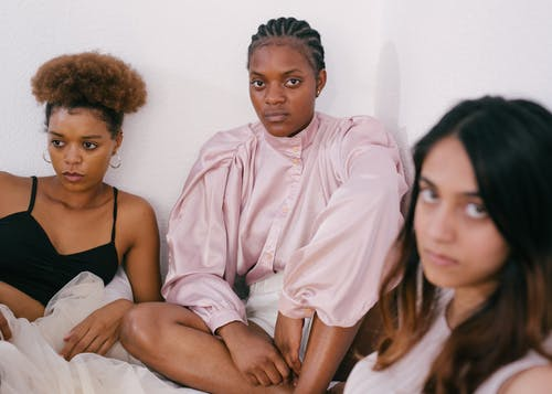 Photo of Women Looking Serious