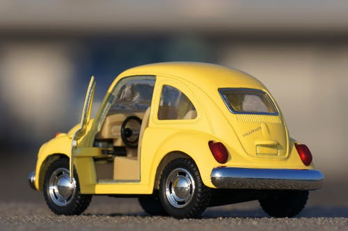Yellow Volkswagen Beetle Die-cast on Floor