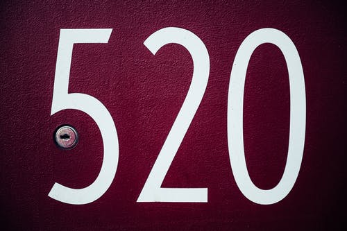 Apartment number on doorway with keyhole