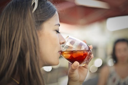 Close-Up Photo of Woman Drinking
