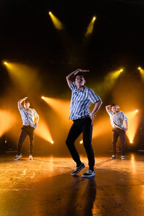 Photo of Men Dancing on Stage