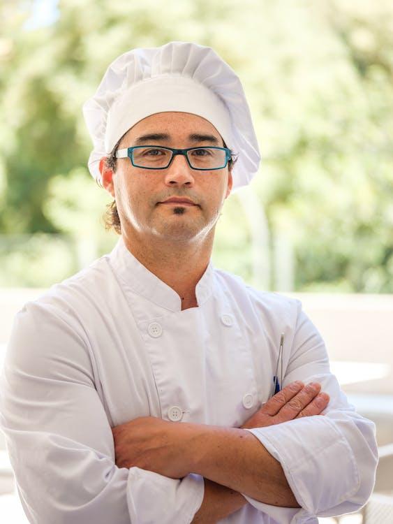 Man in White Dress Shirt Wearing Eyeglasses
