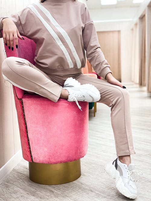 Stylish woman sitting on design armchair