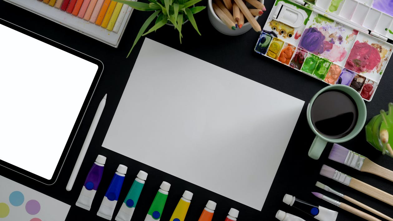 White Printer Paper on Black Table