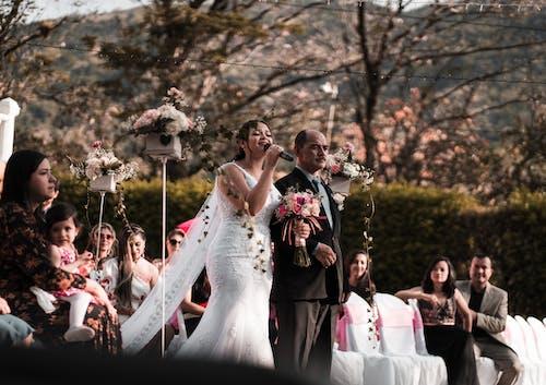 Happy newlywed giving speech on wedding celebration
