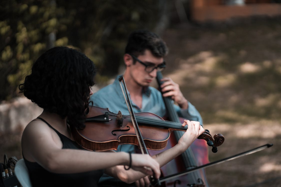 Man and Woman Playing Violin