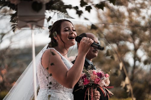 Expressive bride singing on wedding celebration