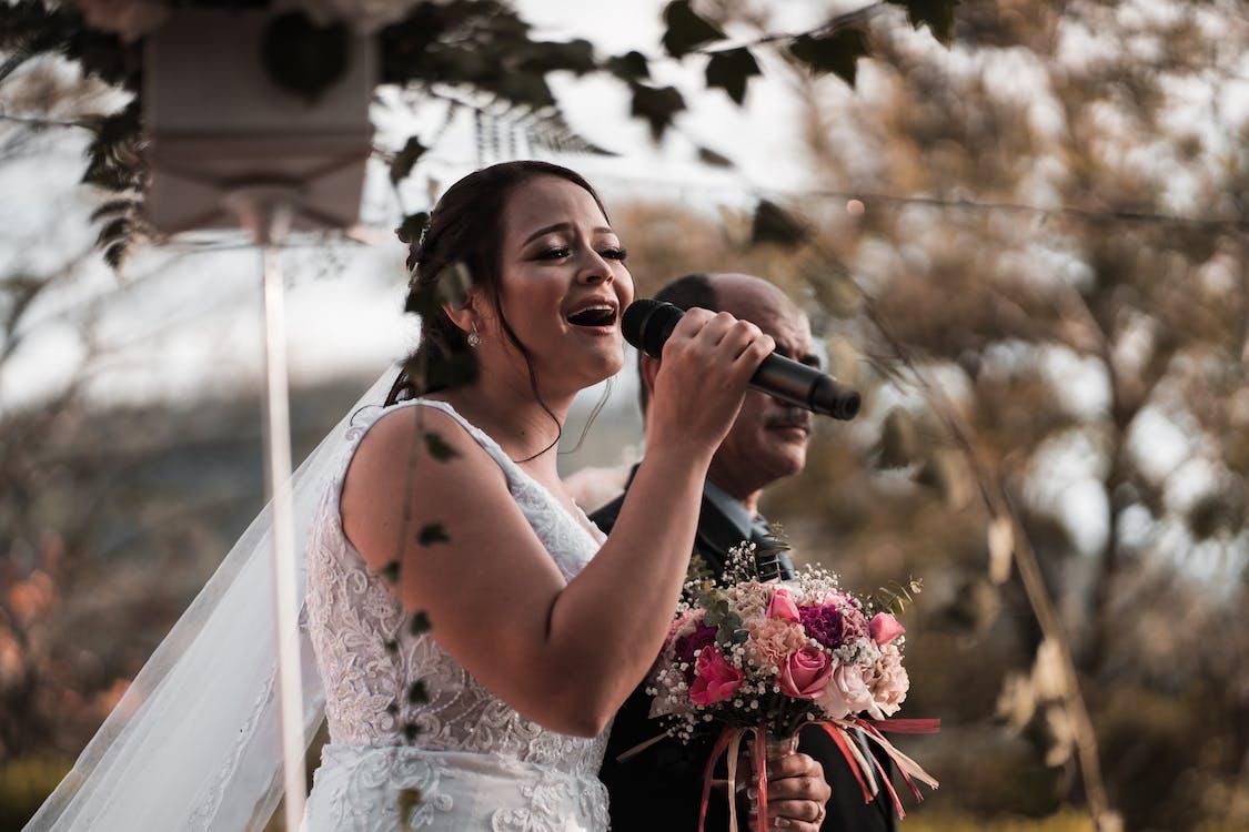 Expressive bride singing on wedding celebration