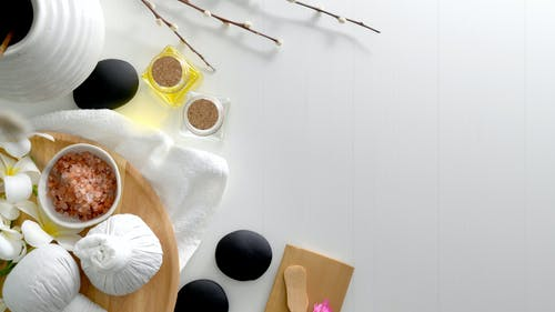 Spa Relaxation Tools on a Wooden Table