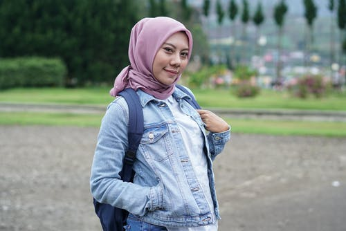 Photo of Woman Wearing Pink Hijab and Denim Jacket