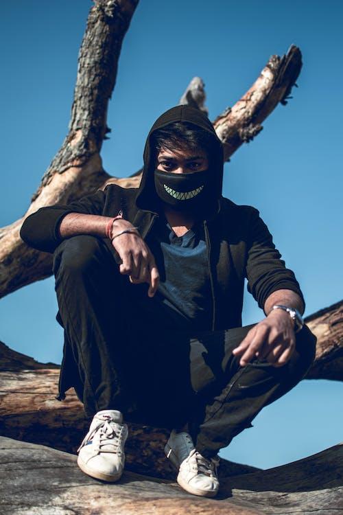 Free stock photo of black jacket, black mask, mask, masked man