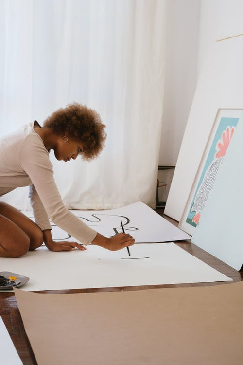 Photo of Woman Painting on White Illustration Board