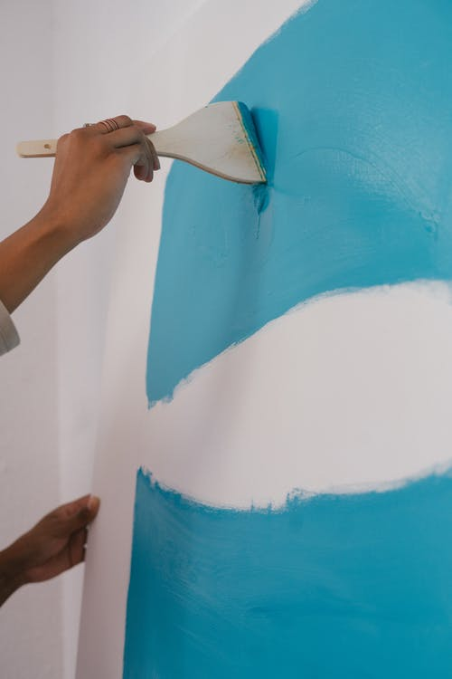 Photo of Person Painting