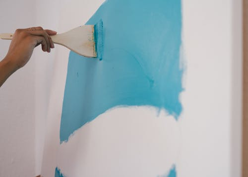 Person Painting Blue Paint