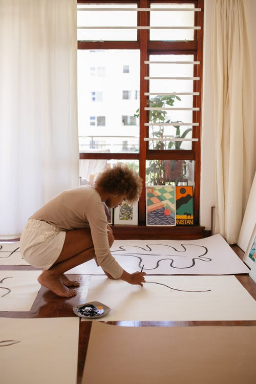 Photo Of Woman Drawing On White Canvass