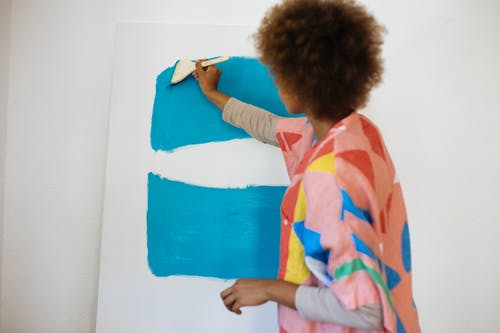 Woman Painting With Blue Paint