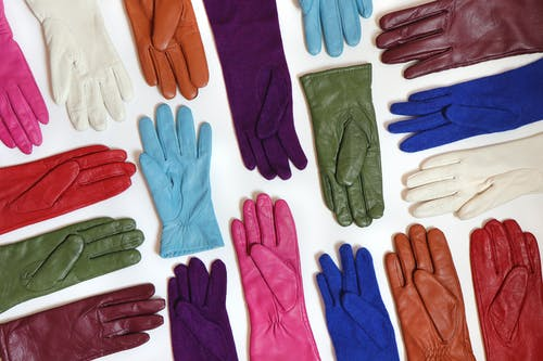 Assorted Color Gloves on White Surface