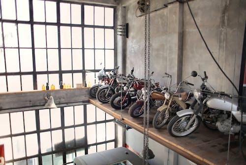 Retro motorbikes parked in row on special platform in garage