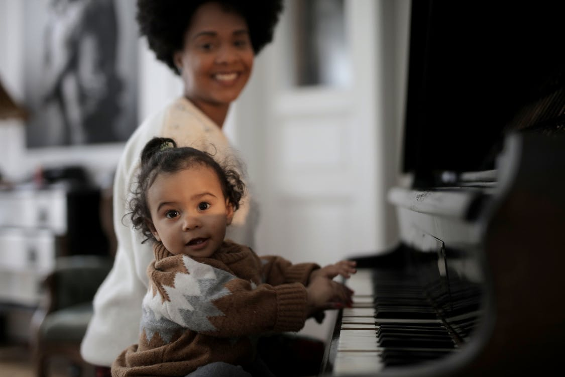 Photo of Toddler Playing Piano