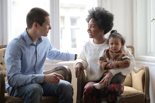 Multiethnic family sitting together at home