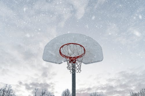 Photo of Basketball Hoop While Snowing