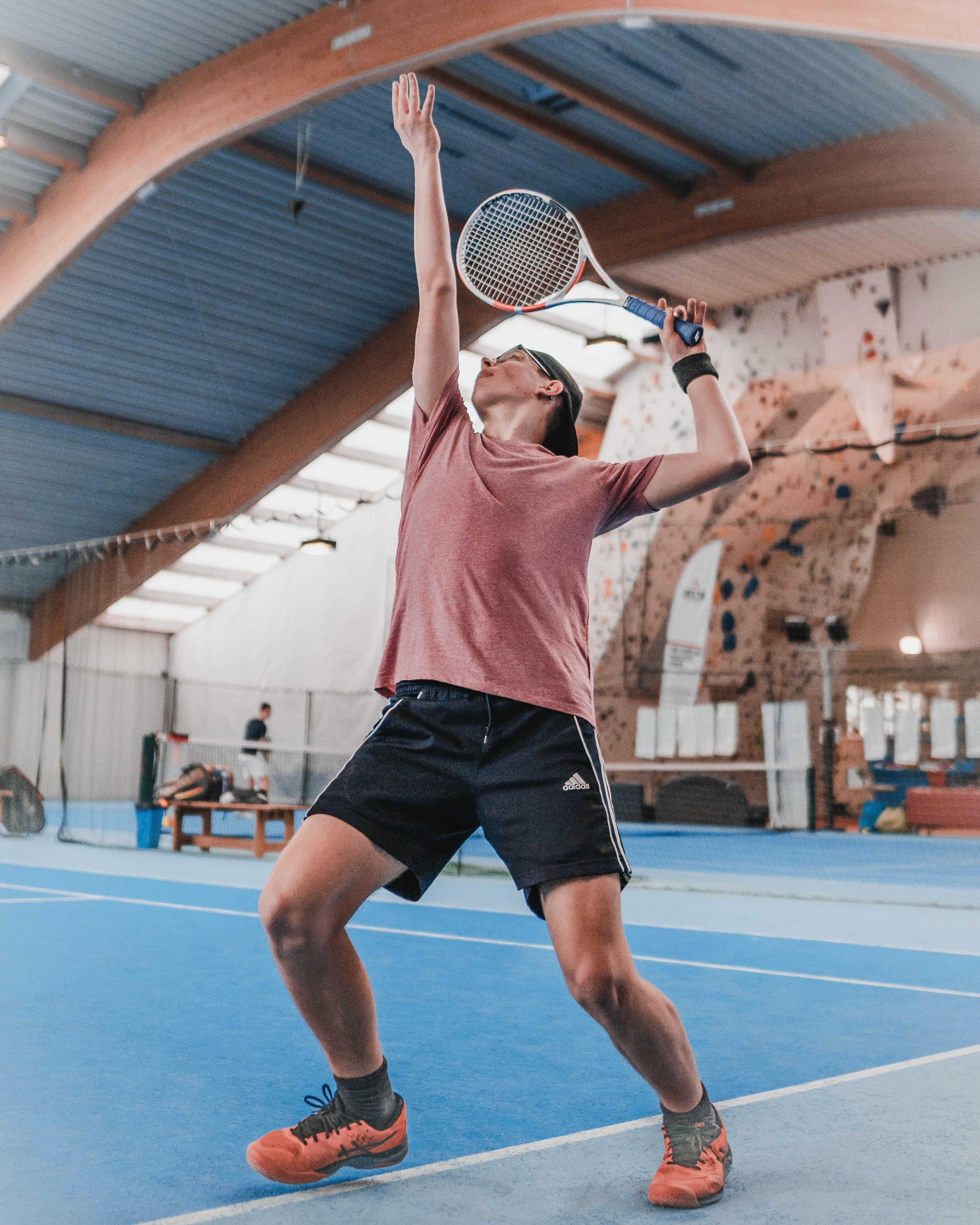 man hitting a tennis ball with a racquet