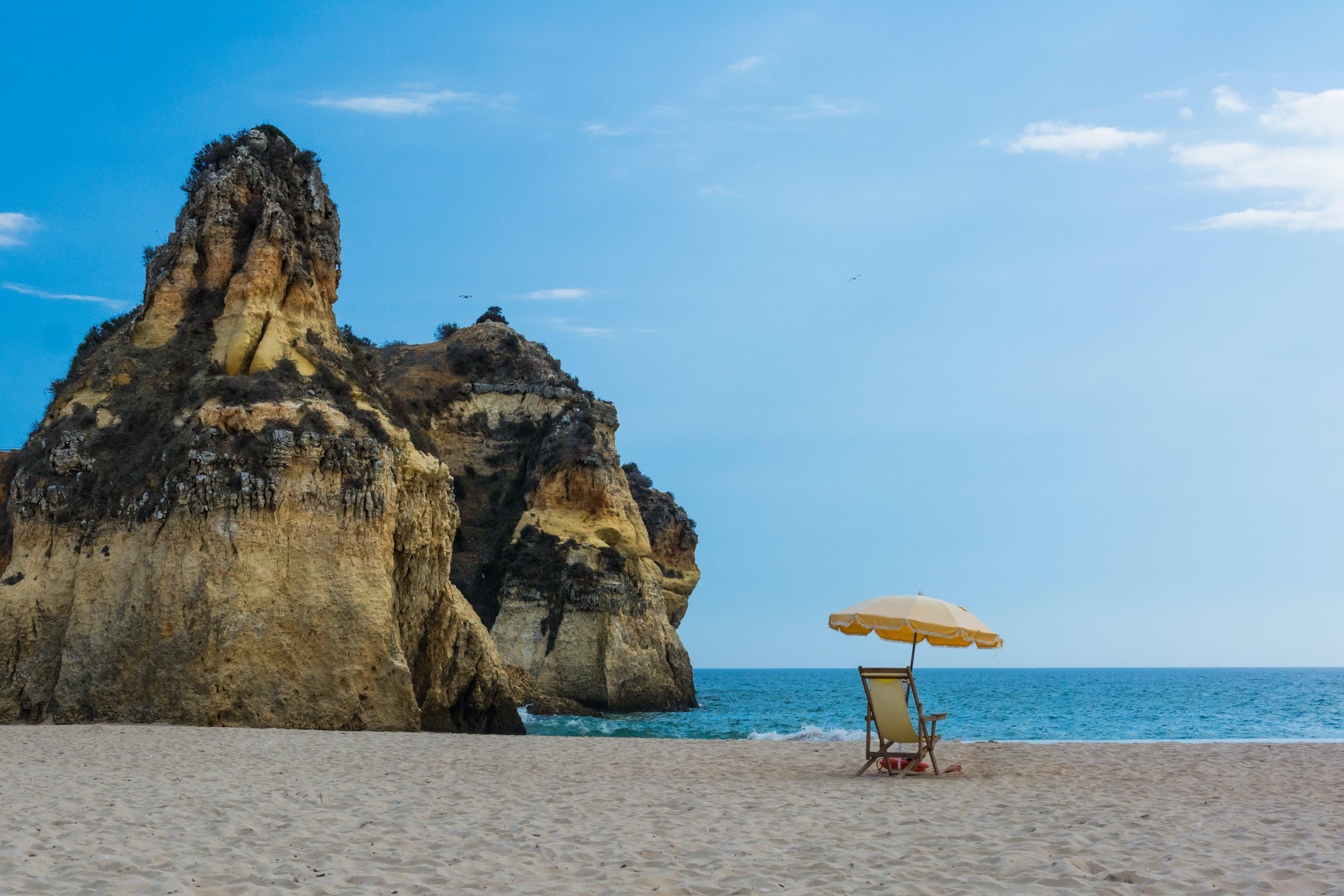 Brown Patio Umbrella Beside Shore Sand