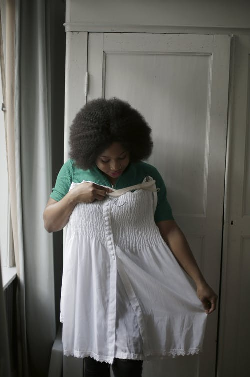 Photo of Woman Fitting Her White Dress
