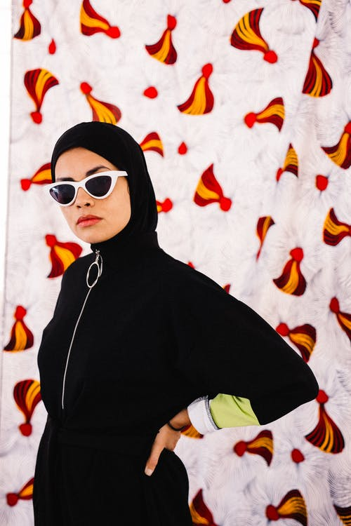 Woman in Black Hijab and White Framed Sunglasses