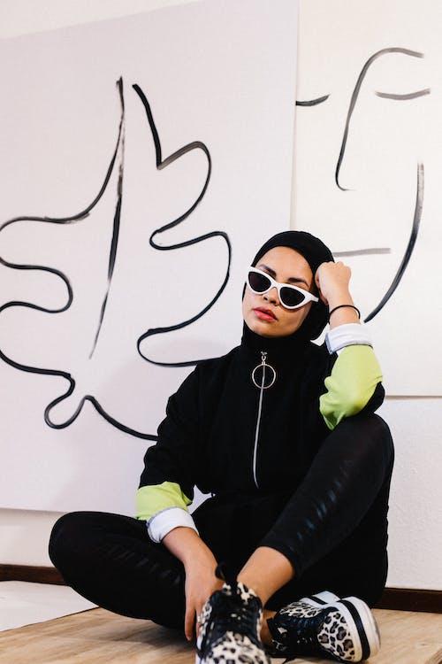 Woman in Black Jacket Wearing Sunglasses