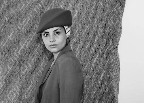 Grayscale Photo of Woman in Beret and Coat