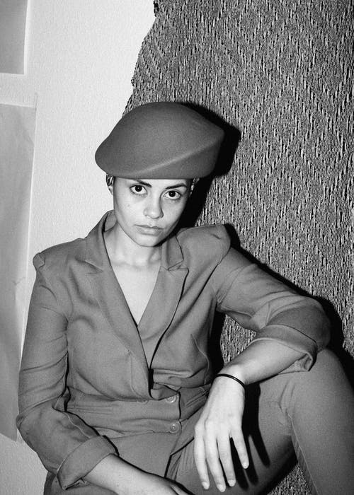 Grayscale Photo of Woman Wearing Beret and Coat