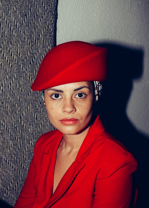 Woman in Red Collared Shirt Wearing Red Cap