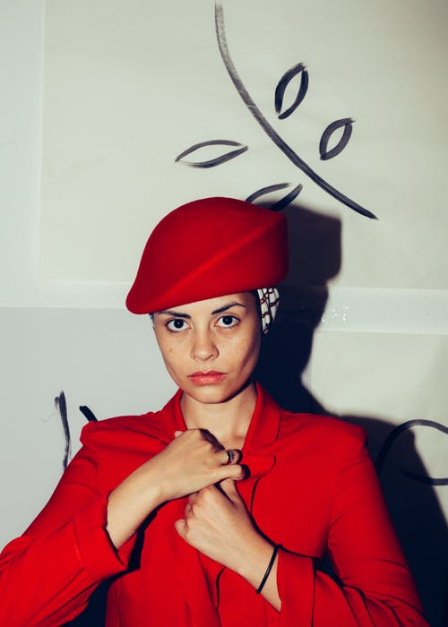 Woman in Red Coat and Red Cap