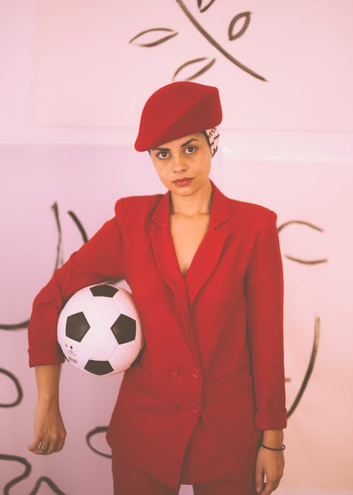 Woman in Red Blazer Holding Soccer Ball