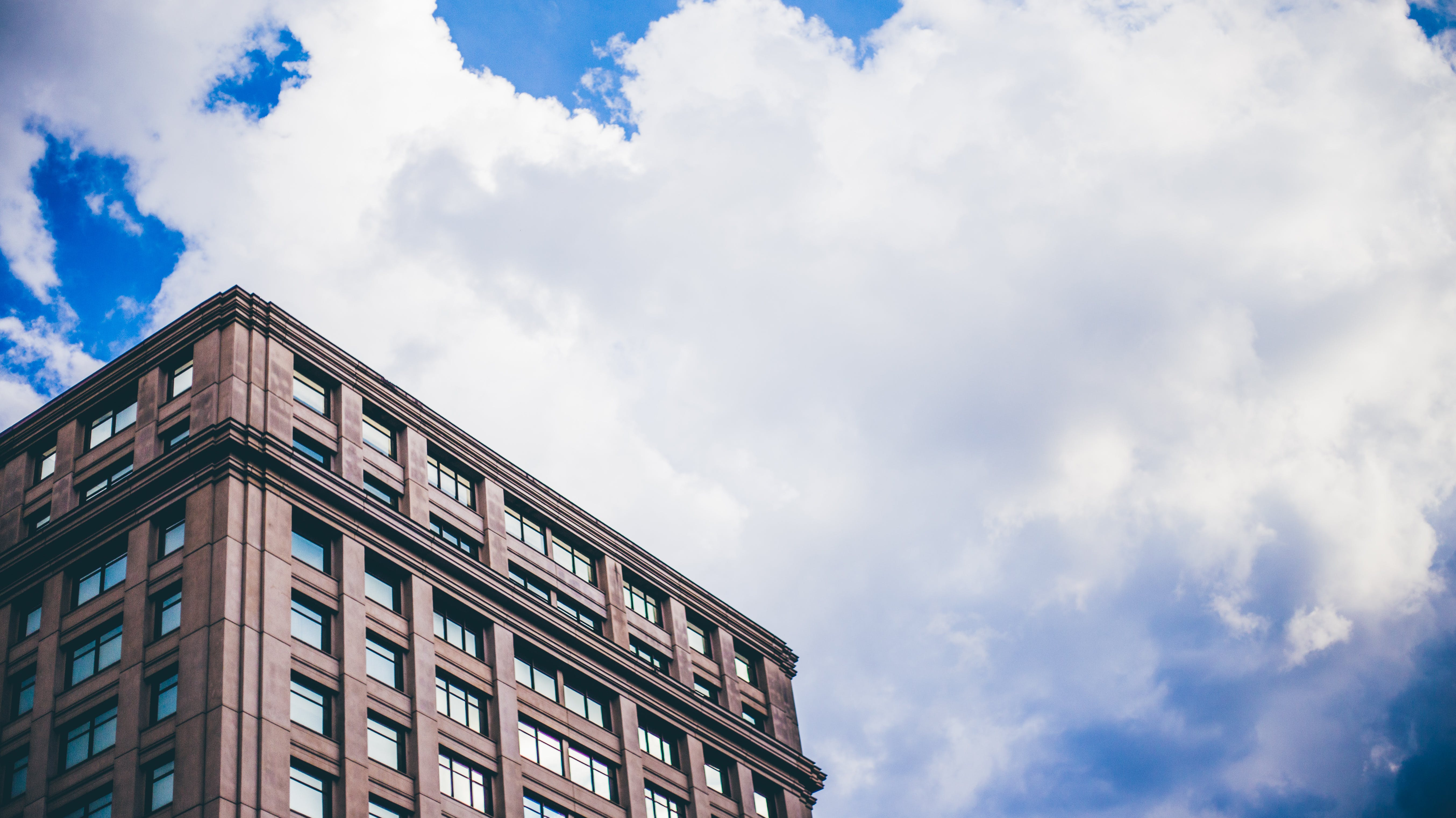 Brown Building Under White Clouds