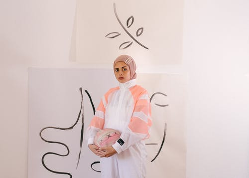 Photo of Woman Wearing Hijab While Holding Ball
