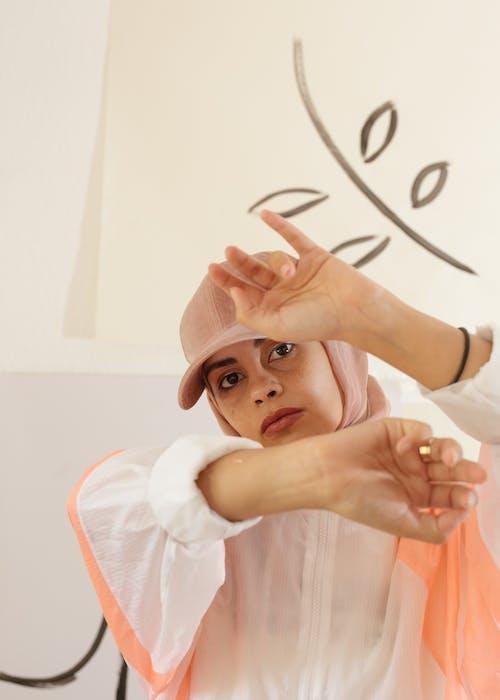 Woman Wearing Pink Cap
