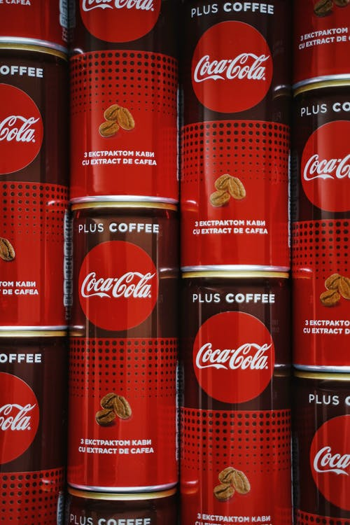 Piled Coca Cola Canned Sodas