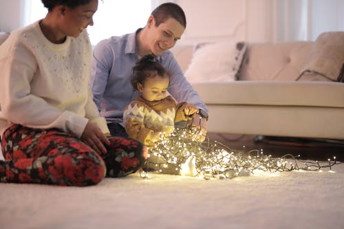 Photo of Kid Playing With String Lights