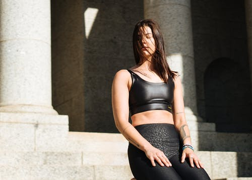 Woman in Black Sports Bra and Black Leggings