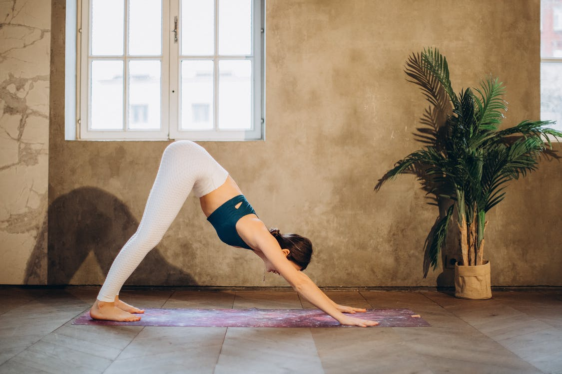 Woman in Downward Dog Pose