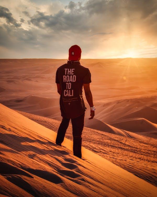 Photo of Man Standing on Desert