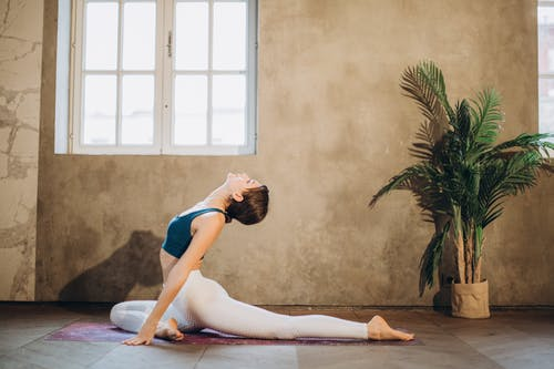 Woman Practicing Yoga Backbend