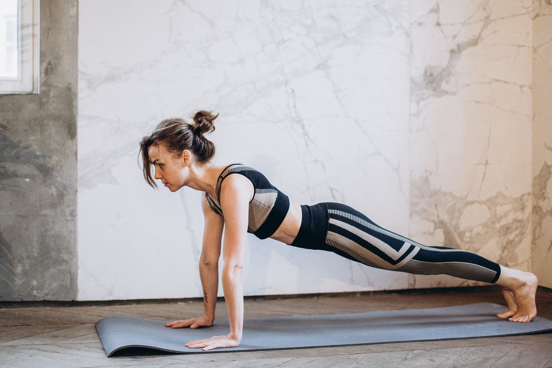 Woman in Black Tank Top and Black Leggings Doing Yoga