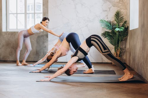Yoga Instructor Helping a Student