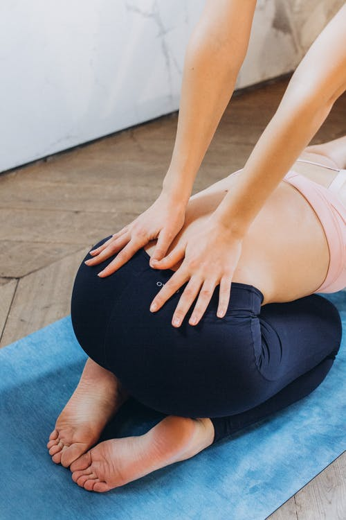 Hands Pressing Lower Back