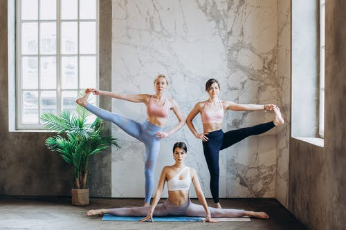 3 Women Practicing Yoga