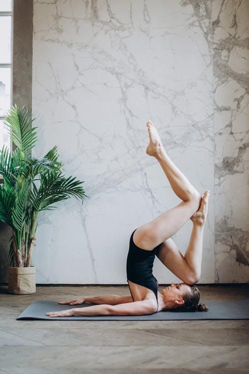 Woman Wearing Black leotard Doing Yoga Pose