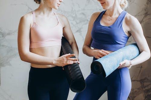Women With Yoga Mats Talking